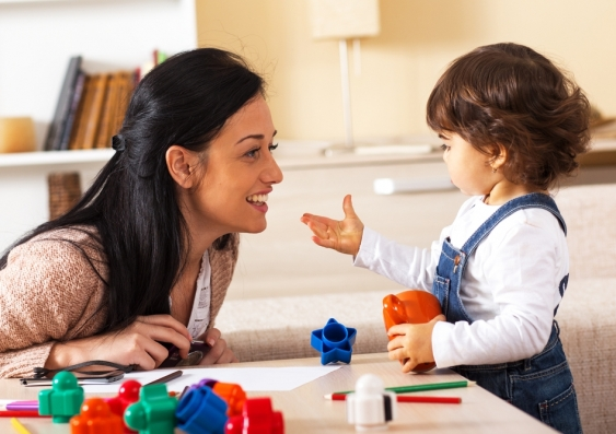 a mother and child playing with plastic blocks