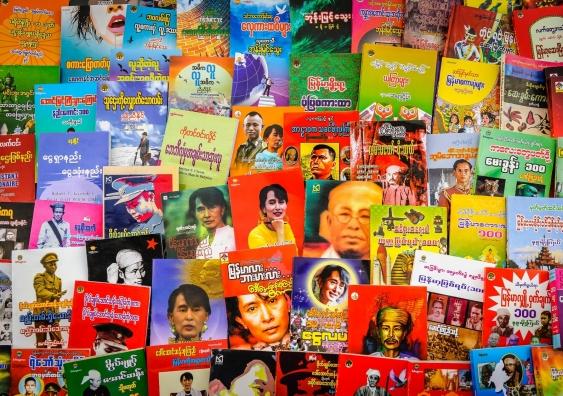 A poster wall of photos of Aung San Suu Kyi.
