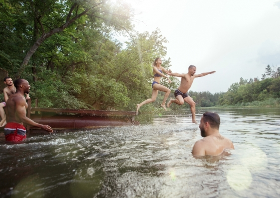 People jumping into river