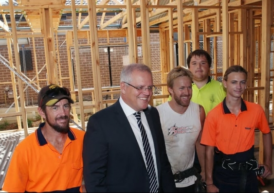 Scott Morrison and four construction workers smiling