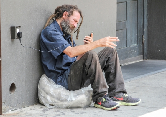 homeless man phone.jpg