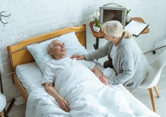 Elderly man in a coma