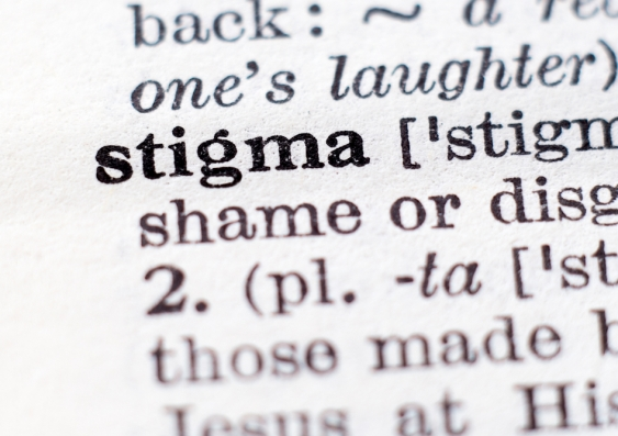 A close-up of the entry in a dictionary for the word stigma