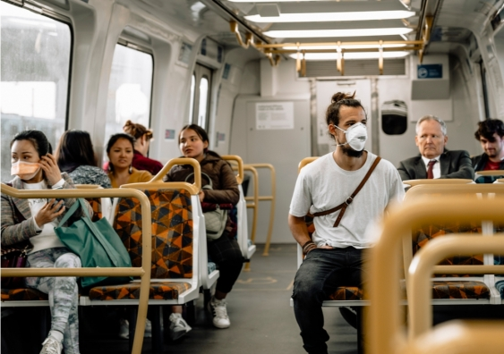 Commuters on a train in Melbourne wear a mask to protect themselves against COVID-19.