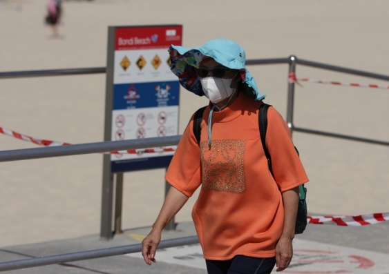 woman wearing a face mask at Bondi beach