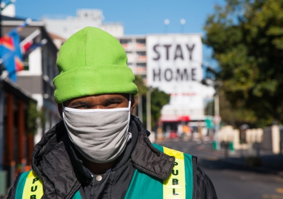 A man with a facemask walks down an empty street in Cape Town, South Africa