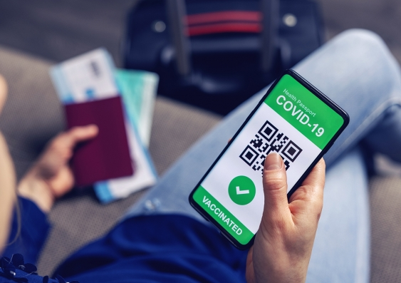 A vaccinated person using the digital health passport app on their mobile phone.