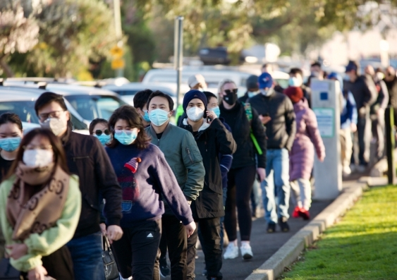 Melbourne, Victoria, Australia, August 30 2021: Queues of people waiting to get coronavirus vaccine outside Peanut Farm St Kilda walk-in covid-19 vaccination clinic. Crowds of young people lining up.