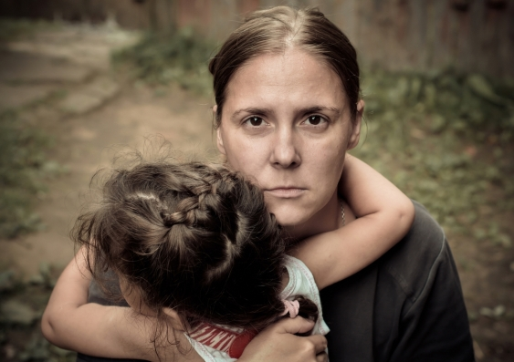 Unhappy woman holding a child