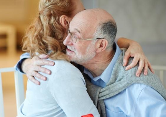 adults hugging