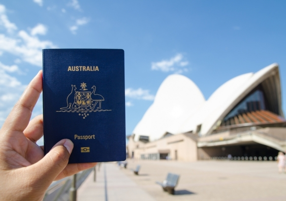 Australian passport held in front of the Sydney Opera House