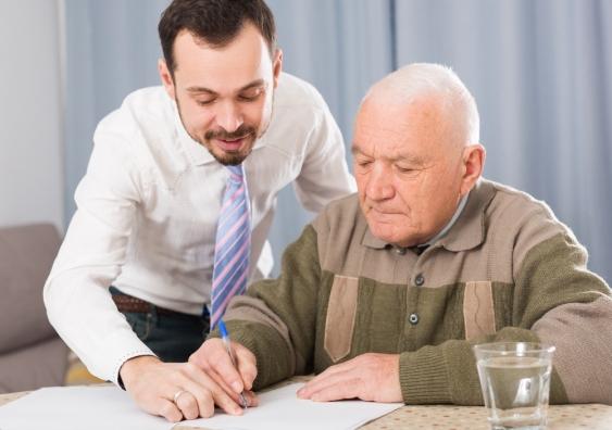 elderly man filling form