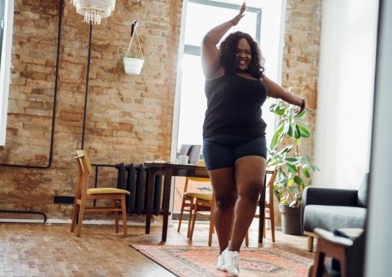 Woman dancing in apartment