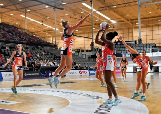 Matilda McDonell defends the shot of Samantha Wallace in the Suncorp Super Netball