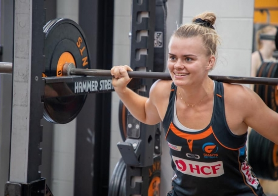 Matilda McDonell at Giants training lifting weights
