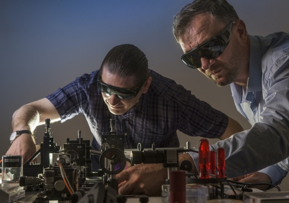 two scientists working on optical beaming of electrical discharge