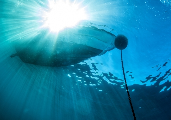 Underwater view of boat and anchor chain