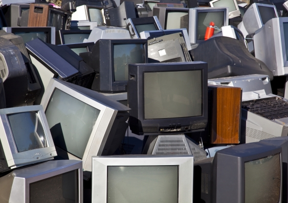 Unwanted analogue TVs piled up