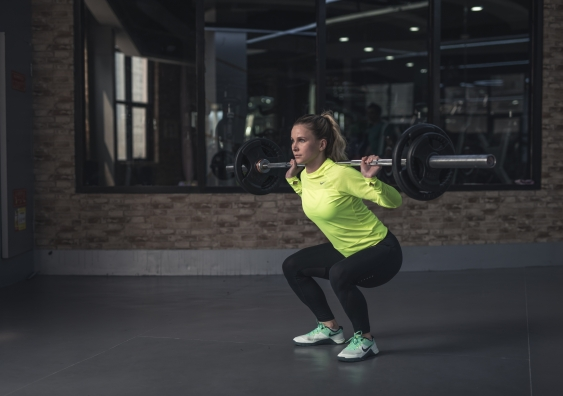A woman lifting a barbell