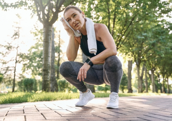 Woman exercising in a park stops to take a break