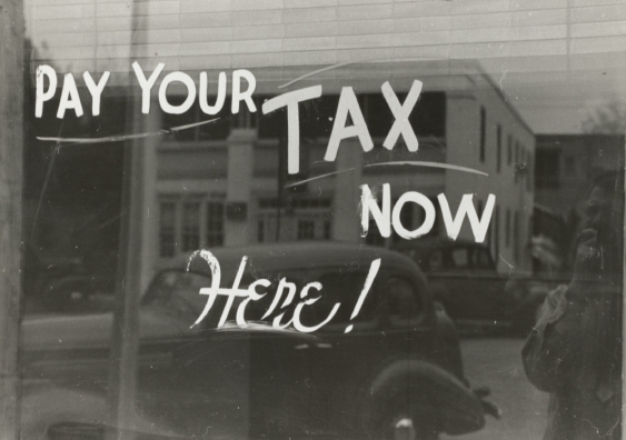 Writing on window says pay your tax here