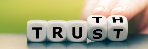 Five cubes with the last two letters alternating to spell either TRUST or TRUTH