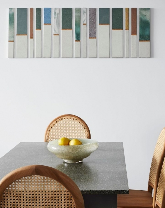 artwork and dining table are made from green ceramics