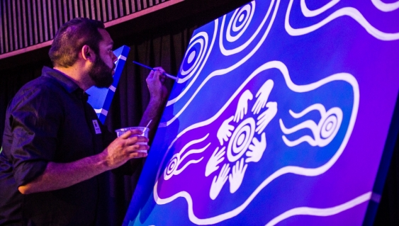 artist_dennis_golding_works_on_the_painting_pathways_to_our_right_photo_by_diane_macdonald.jpg
