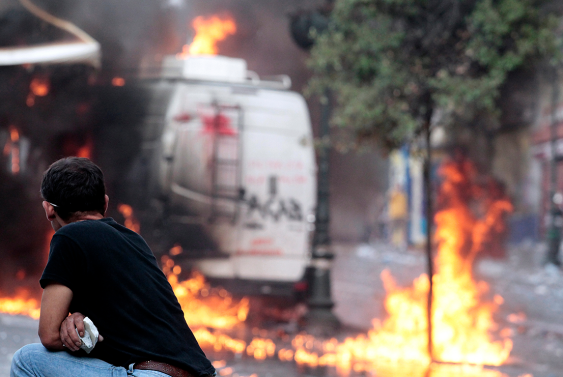 A van burns during protests in Greece