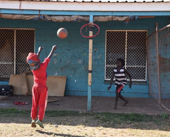 indigenous children play basketball