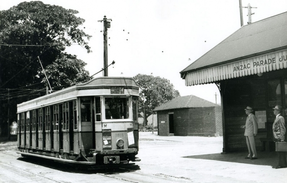 old_electric_tram_travelling_along_anzac_parade_towards_the_city_at_maroubra_junction.jpg