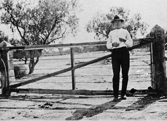 Police officer standing by the gate at the border of New South Wales in 1919