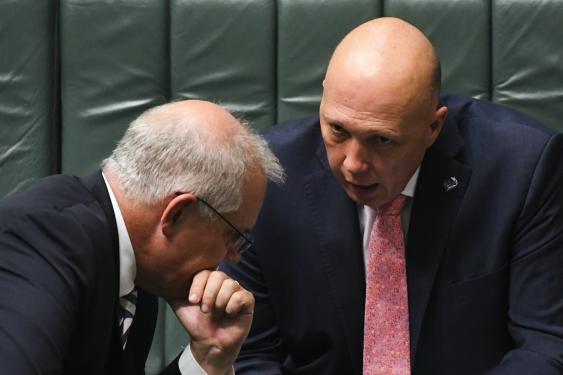 scott morrison and peter dutton confer in parliament