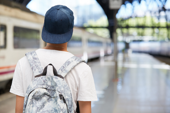 Teen boy wearing cap and backpack
