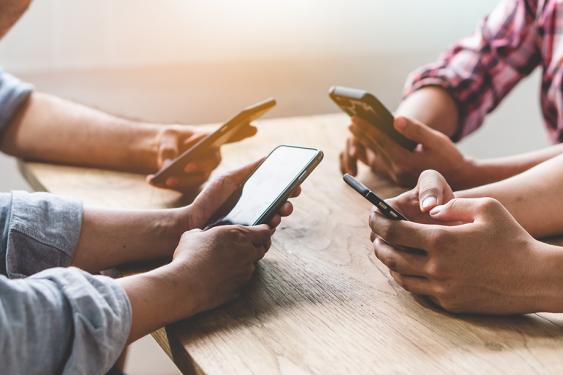 Teenagers texting on phones