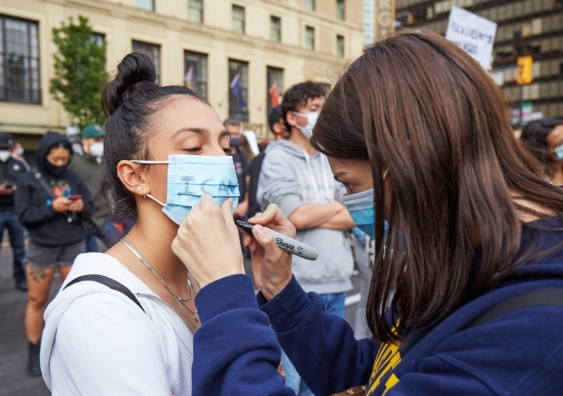 COVID-19 sparked political, cultural and social tensions around the world – and face masks became their battleground. Photo: Michal Urbanek / Shutterstock.