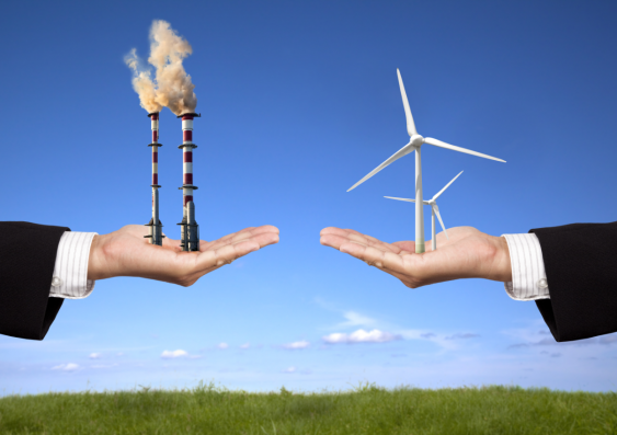 Two hands, one holding fossil fuels and the other with renewable energy