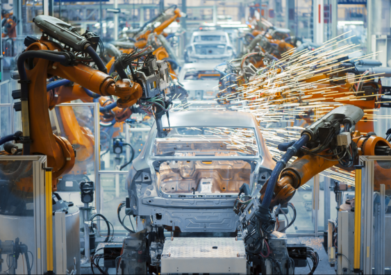 Cars being built on a manufacturing line.