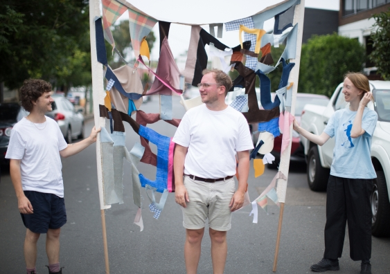 The shapes within the textile banners are abstracted from the phrase Who's laughing jackass, UNSW Honours students Joshua Reeves and Lisa Dwyer with artist Fernando do Campo