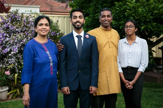 UNSW Law student Sanjay Alapakkam standing with three of his family members.