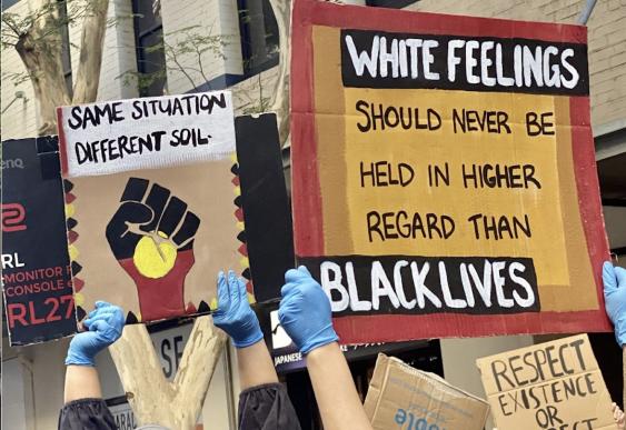 People holding 'Black lives matter' signage in Brisbane protest.