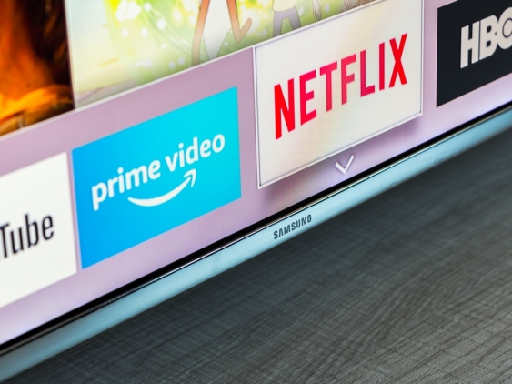 Samsung smart TV with video streaming apps: YouTube, Amazon Prime Video, Netflix and HBO.