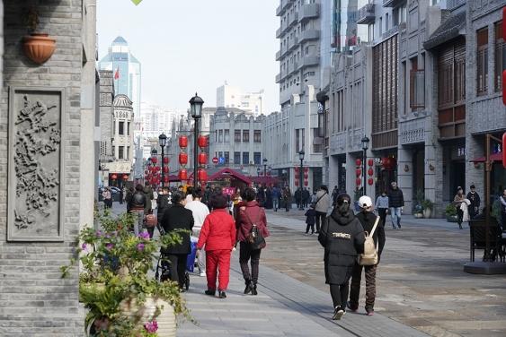 people walking on renovated zen street mall area