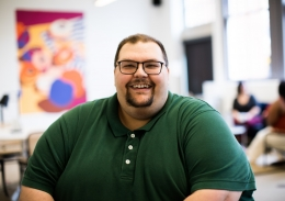 Plus size man smiling in an office setting