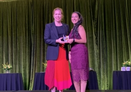 Alex Blackwell presents an award to Miriam Abd Elmesseh