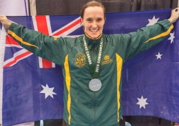 Dr Mandy Hagstrom with a medal and the Australian flag