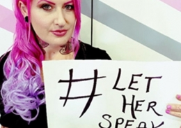 Zahra Stardust holding a sign saying #Let her speak