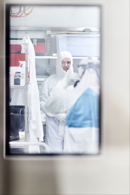Stuart Turville and Alberto Ospina Stella preparing to enter the Kirby Institute PC3 containment lab