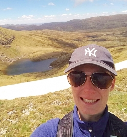 Scientist Dr Zoë Thomas takes a selfie in front of Club Lake