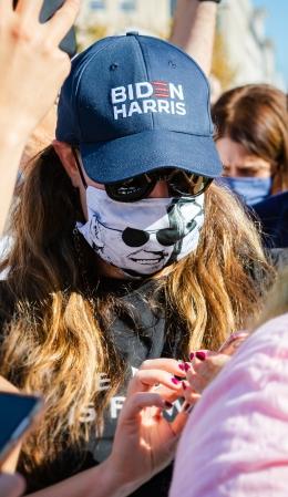 Woman wearing face mask with Joe Biden's face